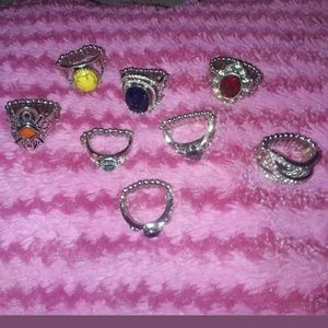 8 Beautiful rings by Paparazzi  size 6 -10